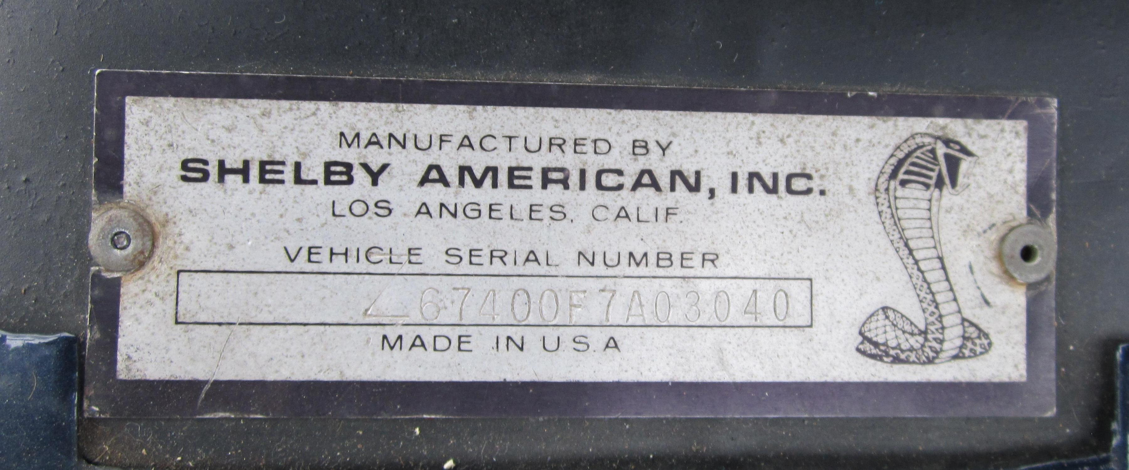 Original shelby american vin tag riveted onto the body next to the left side fender